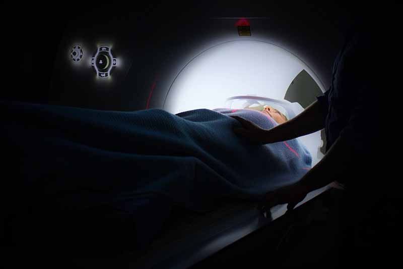 Picture of a lady gong into an MRI medical scanner