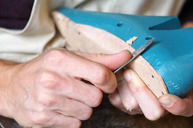 Picture of a mans hands making shoes