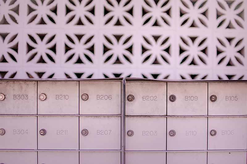 Picture of a group of white letterboxes