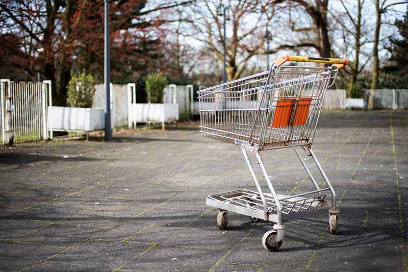 Picture of an abandoned shopping trolley in a car park