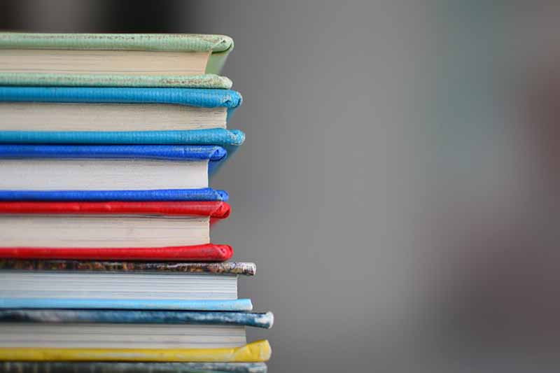 Picture of a stack of coloured books